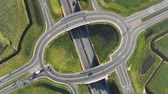 dálnice : Aerial view from the top of the roundabout on the highway. Cars moving at the junction of the highway in the Netherlands