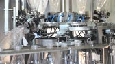 produtividade : Plant for the production of mineral water. Water bottling in plastic white Stock Footage