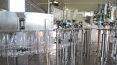 mechanics : Plant for the production of mineral water. Water bottling in plastic white Stock Footage