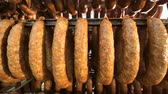 bakkaliye : A batch of finished sausage in the form of rings, stored on the shelves in the production. A kind of sausage from the bottom to the top Stok Video