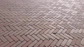 blokken : The background of the famous Red pavers Holland. A method of laying paving slabs with a diamond. Park path made of stone. Stockvideo