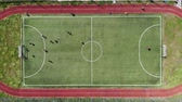 tribunal : Aerial view on top. Children play score a goal by playing football on a small football field. Vídeos
