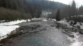 terreno extremo : Low flying over the river in the winter mountains. winter carpathian Ukraine