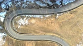 vadi : aerial View from the top of the serpentine road in the winter mountains, and the cars that move on the road