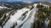 congelados : Aerial view Biathlon. Winter sports in the mountains. Cross country skiing in the Ukrainian Carpathians