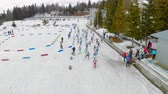 deslizamento : Ukraine. Yavoriv. 12 march 2019. Aerial view Biathlon in the mountains. Students participate in local competition balonu. Start the race. A group of athletes starts the race