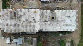 クレーン : Aerial view of the construction site, and the construction crane from the top. Panorama of the construction site