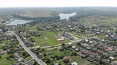 ormanda yaşayan : Beautiful panorama of the Ukrainian village from a height. Flight over the Ukrainian village. A large lake near the village. Stok Video