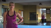 ginásio : Blonde fitness model gives intense look at end of workout in slow motion.  (Shot at 240fps with Sony FS700) Stock Footage
