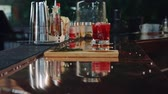 tumblers : hands of a man and a woman taking coctails from the bar counter Stock Footage