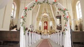 ベンチ : Wedding in a chapel Catholic church 動画素材