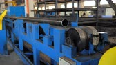 lakatosmunka : Rolling forming rolls metal works on manufacture of pipes. Rolling mill machine for rolling steel sheet. Rolling mill machine with cooling water close up Stock mozgókép