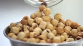 com casca : shelled hazelnuts poured from the jar in a bowl