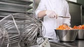 conserva : hands pastry chef spread the sugar on the apricots fruit, prepare the jam in the industrial kitchen worktop.
