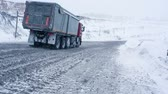 отопление : Mining dump truck driving on snowy road to coal cut in Siberia in Russia in winter. Machinery for heavy industry carrying fossil. Car with huge wheel. Energy and power. Work for dirty environment