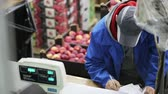weigher : Russia, Novosibirsk - July 25, 2015: Man fills the papers. An employee working in the company for the supply of fruits and vegetables. Food distribution by trader of retail and wholesale trade Stock Footage