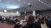 Novosibirsk Russia - April 1 2018: Modern space for startup company of programmers career. Commerce cooperation and success in large room. Successful marketing of finance in full place of many viewers Vídeos