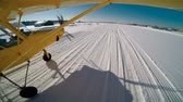 no people : Yellow airplane landing on snow Stock Footage