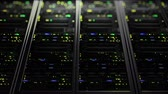 hostia : 3D rendering of dark modern working data servers with flashing LED lights. Data servers loopable animation