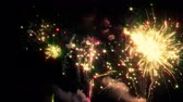 Brightly colorful fireworks in the night sky. Bright festive salute flashes perfectly complement the festive atmosphere. looped Stock Footage