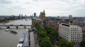 westminster : Aerial panorama of central London, UK. Features the River Thames, Millennium Wheel (London Eye),  South Bank area. Stock Footage