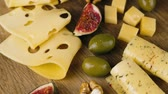 different cheeses : A set of different cheeses with figs, turns to the camera Stock Footage