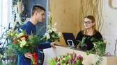 ceramic : Good looking man buys a bouquet at a flower shop Stock Footage