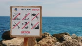 proibir : Hurghada, Egypt - February 25, 2016  The plate with the rules of behavior in the Red sea Stock Footage