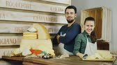 distribuidor : Portrait of a successful team - salesmen in the cheese store Vídeos