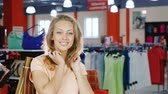 shopaholic : Portrait of satisfied women customers with shopping bags. Smiling, Stock Footage