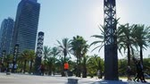 ostrý : Barcelona, Spain - June 20, 2016: The street along the waterfront of Barcelona, people walk along the avenue of palms Dostupné videozáznamy