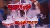 stink : Hand of the waiter in white gloves pour steaming champagne at a party Stock Footage