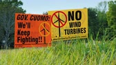 proximidade : Wilson, NY, USA, September 2017: Poster with agitation against wind turbines. People are outraged by the proximity and size of wind generators