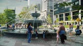 architektonický : Toronto, Canada, October 2017: People are resting near a new fountain with dogs in Toronto. Children play, people with pets walk