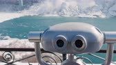 niagara : Niagara Falls without tourists in the winter season. A row of binoculars, no one is near