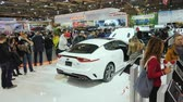 kia : Toronto, Canada, February 20, 2018: Visitors to an automobile exhibition near the new KIA model, admiring cars at one of the largest exhibitions in the world