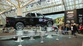 admirado : Toronto, Canada, February 20, 2018: Black off-road car RAM at an exhibition in Toronto. Visitors are admired by cars at a huge exhibition of cars