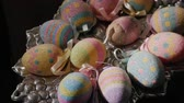 fundo colorido : Silver plate with decorative Easter eggs. Preparing for Easter Stock Footage