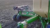 sows : Spring work in the field is the sowing of cereals. Part of a modern sowing machine