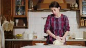 gumka : A woman kneading pizza dough in her kitchen