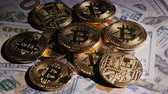 шифрование : Several coins of crypto currency bitcoin against the background of American dollars. Crypto currency concept