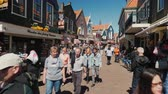pescador : Volendam, Netherlands, May 2018: Narrow street of a fishing village. Many tourists walk around souvenir shops and street restaurants. Tourism in the Netherlands