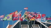 baton : Flags of many countries in an old wooden house. The bottom view of shooting against the blue sky Wideo