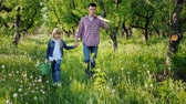 коса : A farmer with a younger sister walks through the apple orchard. Carry a scythe and watering can. Steadicam shot