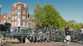 intenso : Amesterdam, Netherlands, May 2018: The active life of Amsterdam is a crossroads with heavy traffic of pedestrians, bicycles and cars. Environmentally friendly transport