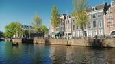 Amesterdam, Netherlands, May 2018: Picturesque canal in Amsterdam. Typical landscape of this city Stock Footage