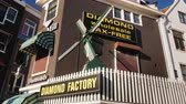 sklep : Amesterdam, Netherlands, May 2018: Original signboard with a windmill. Diamond Factory - a shop in the popular tourist area of Amsterdam