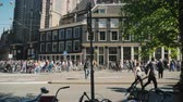 estreito : Amesterdam, Netherlands, May 2018: Mad traffic of tourists in Amesterdam. A crowd of people walking down the street, bicycles in the foreground. Steadicam shot Stock Footage