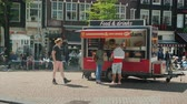 kızartması : Amesterdam, Netherlands, May 2018: A street van with fast food on Amsterdam Street. Tourists and locals buy snacks