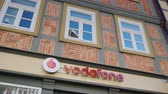 provedor : Wernigerode, Germany, May 2018: The sign of Vodafone is one of the largest mobile operators in Europe. On the facade of an old German house with a recognizable style of construction